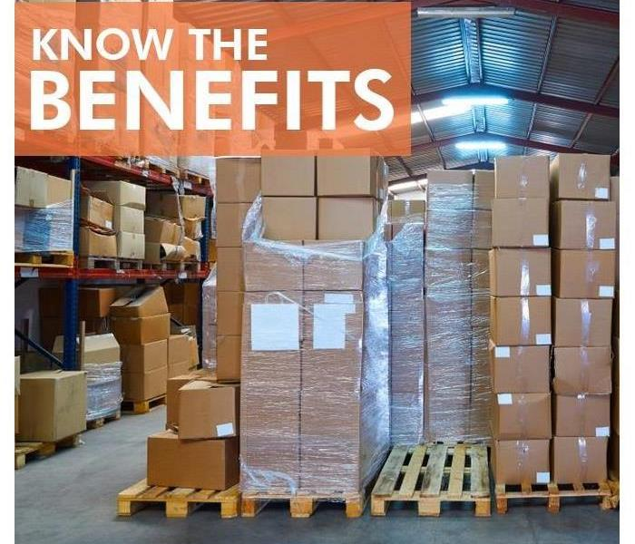 Boxes stacked on a pallet with shrink wrap titled Know The Benefits.