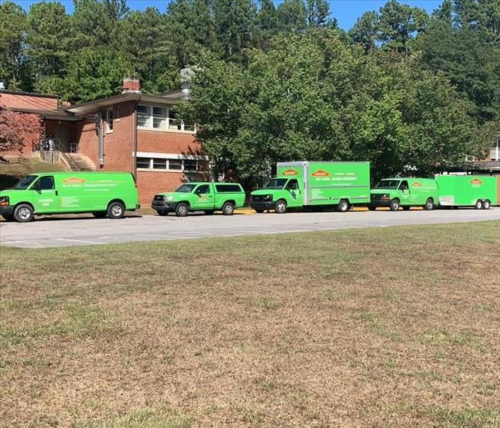 SERVPRO vehicles lining the front of Tenth Street Elementary School.